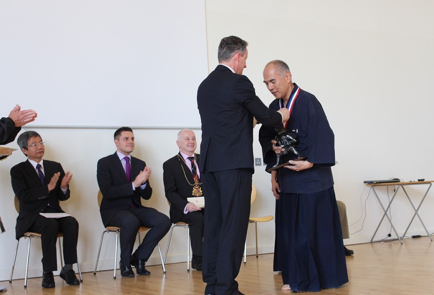 Kazuo Yamazaki presented with medal by Lord Charles Bruce
